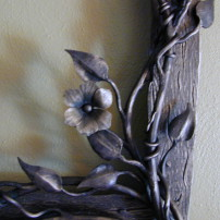 Floral elements on mirror frame